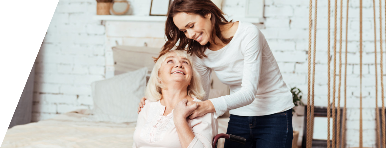 caregiver and elderly woman looking at each other