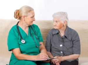 caregiver and an elder woman talking